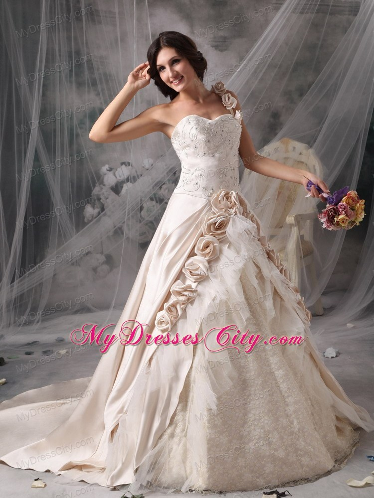 Champagne one shoulder chapel train bridal gown with for Flowers for champagne wedding dress