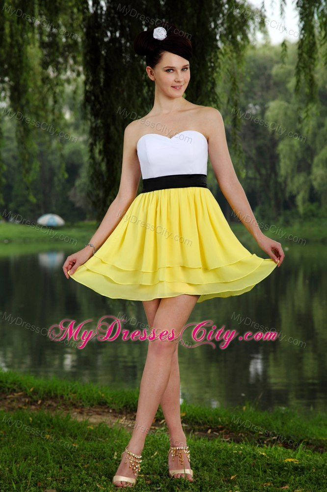 Black dress yellow sash.